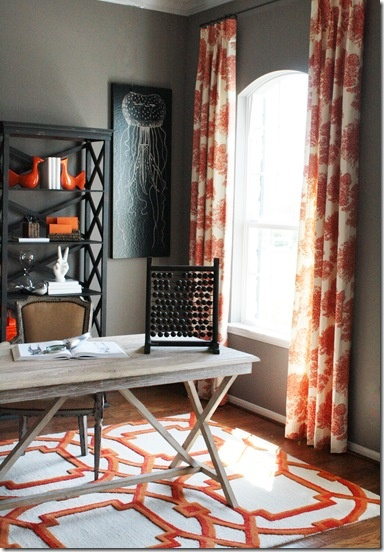 love the orange curtains with grey/brown walls