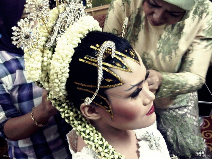 My sister and the beauty of Indonesian traditional Central Java wedding make-up called Paes Ageng. This make-up is used for weddings. It usually takes 3 hours to do the make-up. The make-up artist and the bride will have to do fasting before applying the make-up.