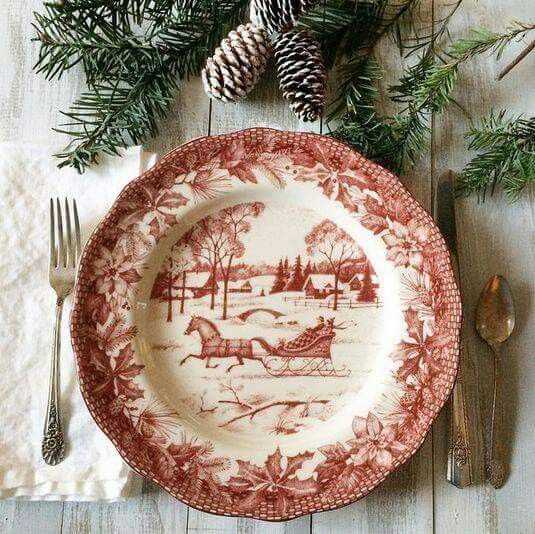 A lovely Christmas table setting featuring these beautiful Currier and Ives china dishes