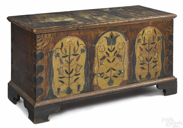 "Pennsylvania or Southern painted poplar dower chest, ca. 1800, the lid with three tombstone panels adorned with tulips and birds, over a case with similar decoration flanked by heart corners, all on an ochre sponged ground, supported by bracket feet, 25"" h., 46 1/4"" w"