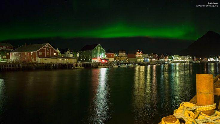 The Aurora Borealis dances over the sleepy fishing town of Henningsvaer, Lofoten Islands, Norway.