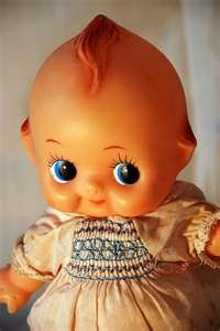 Kewpie Doll  ---  Not so much the doll, but look at the dress....I had that same dress as a child.  I still have it.  it is on a life-size doll.  :0)