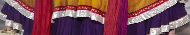 Yellow and Purple Net Double Flare Churidar Kameez Online Shopping: SLKCR3794