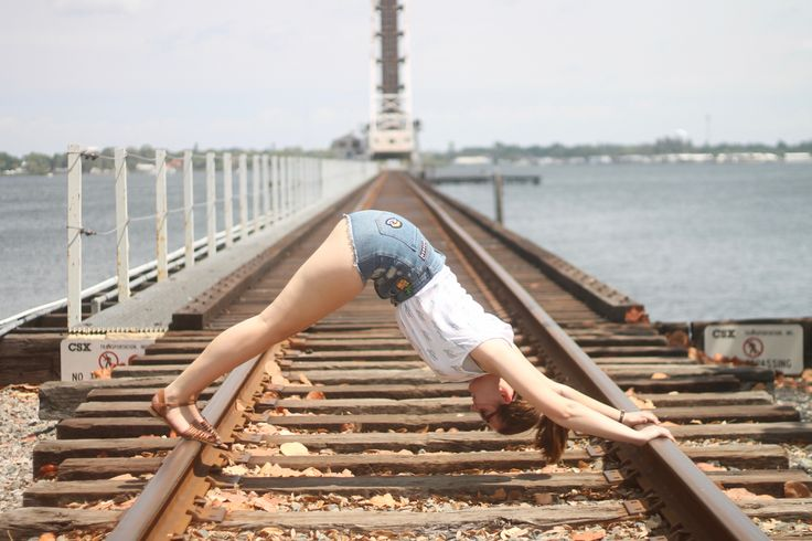 International Day of Yoga - downward facing dog on train tracks