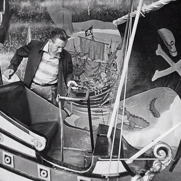 Walt Disney checking out the Peter Pan Ride before getting on.
