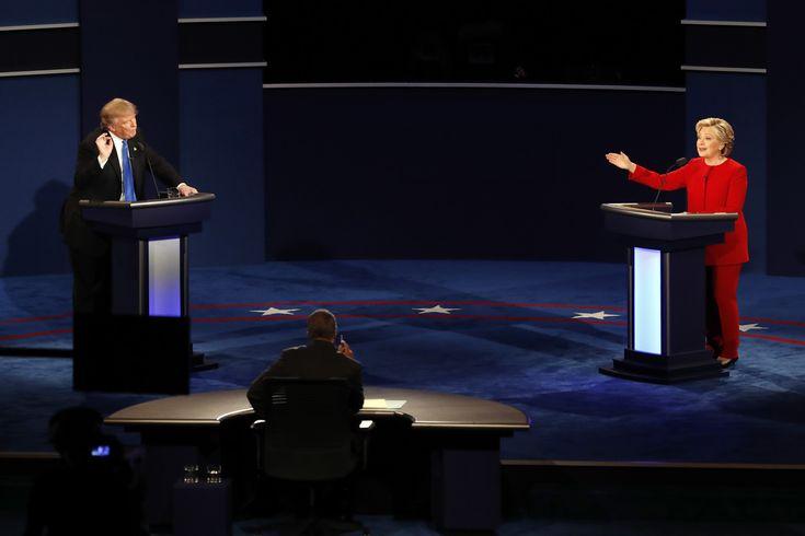 Republican presidential nominee Donald Trump and Democratic presidential nominee Hillary Clinton gesture during the presidential debate at Hofstra University in Hempstead, N.Y. (Mary Altaffer/AP)