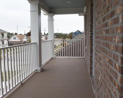 Brick facade, balcony, fiberglass columns, Trex porch boards