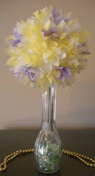 Tissue Paper Flower    By: Christine Weiher    If you're looking for a fun springtime DIY craft for your home then take a look at this Tissue Paper Flower. Using different colored pieces of tissue paper and glue you can have a fabulous centerpiece. This would be a great centerpiece for all the tables at a wedding as it's a quick and easy craft to put together.