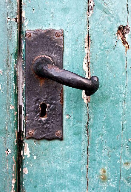 blue green door and old handle knob