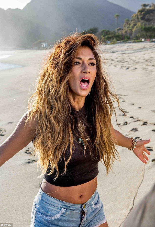 Passionate: Nicole belts out her latest track on the beach in Malibu...