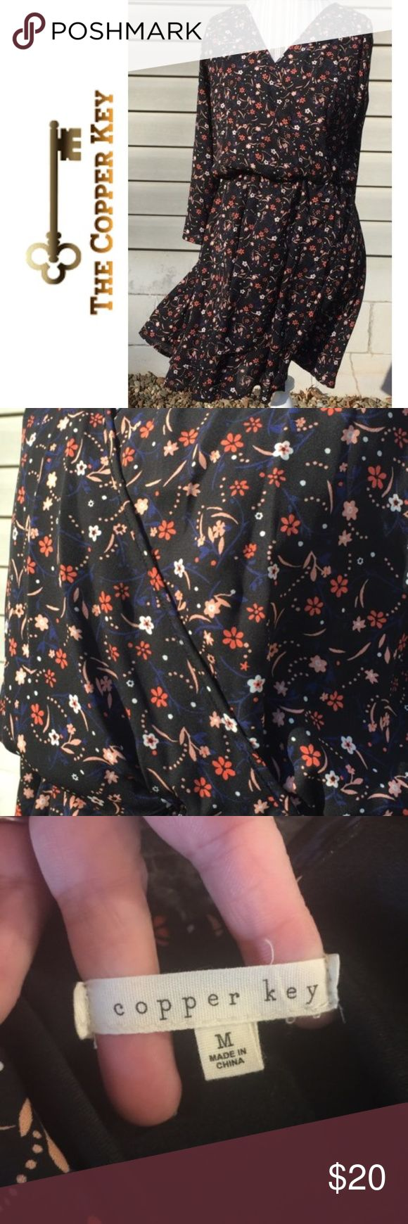 """Copper Key Medium flowing flowery dress EUC Coppery Key flowing flowered dress with a dark navy background.  Faux wrap a round body.  V-neck in front and v-neck with strap across shoulder in back.   19"""" pit to pit and 35"""" in length. Copper Key Dresses Mini"""