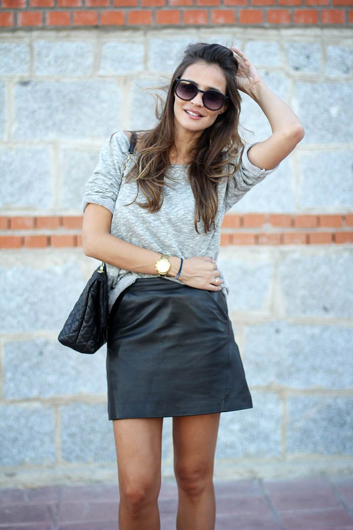 Black leather mini skirt and grey t-shirt