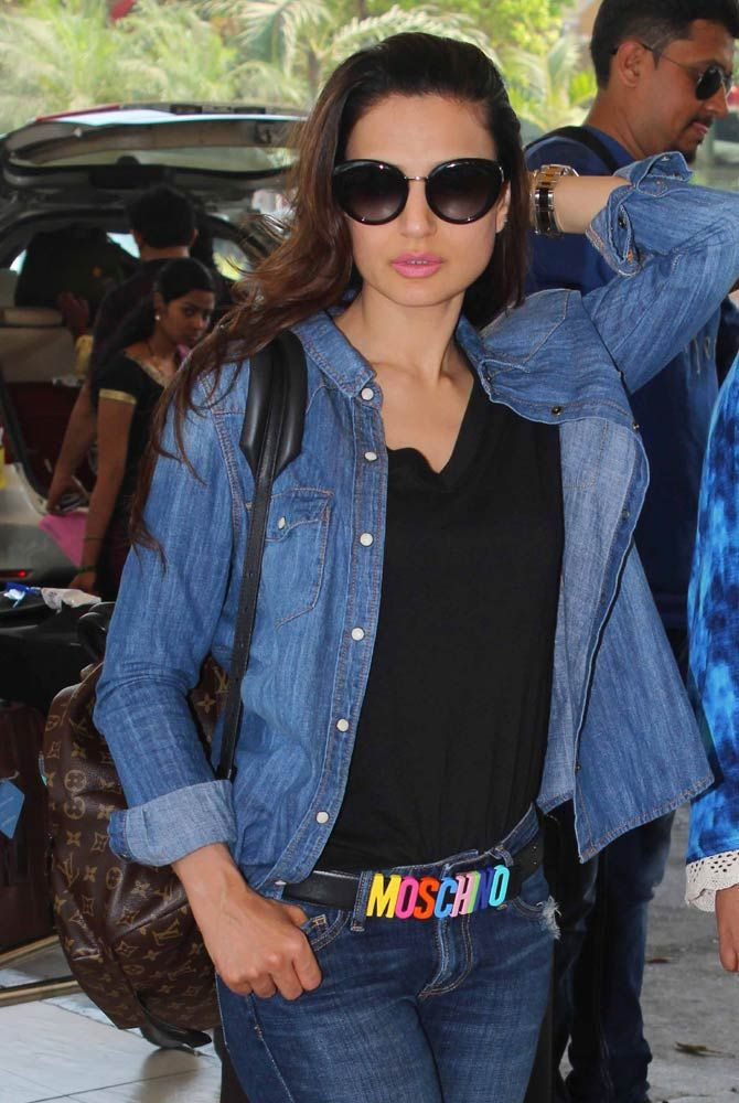 A denim-clad Ameesha Patel poses for the cameras at the Mumbai airport. #Bollywood #Fashion #Style #Beauty #Hot #Sexy