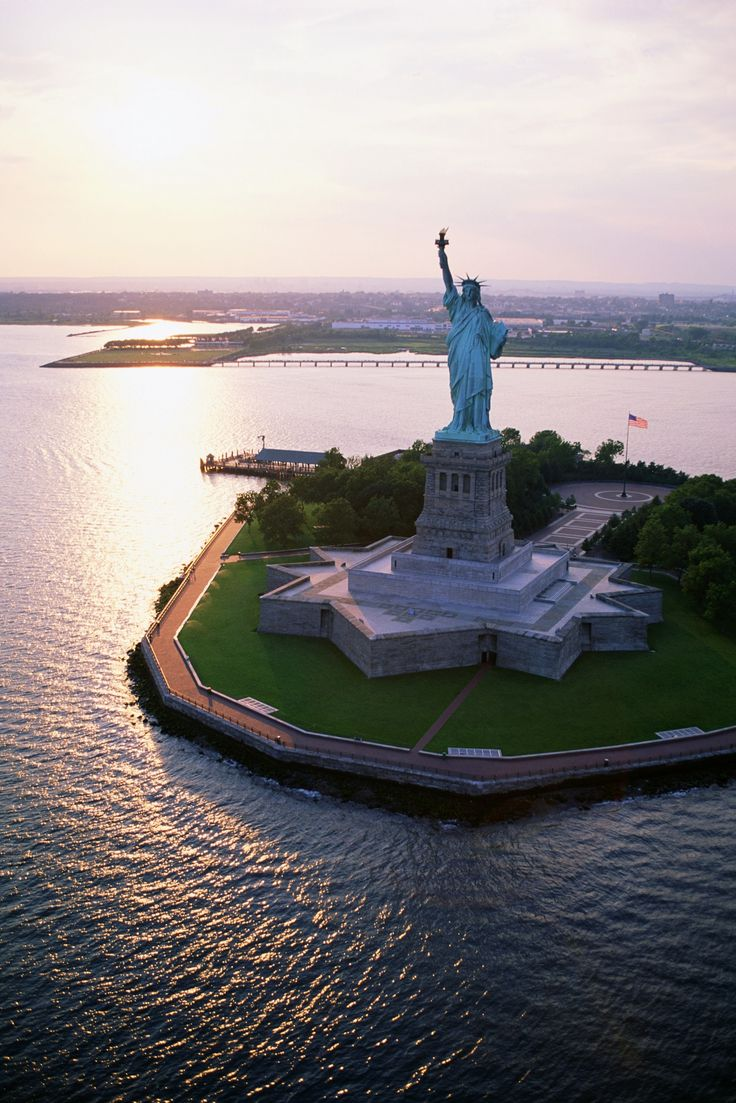 The Statue of Liberty guards the entrance to New York Harbor on Liberty Island. A trip to NYC isn't complete without a visit to this famous landmark!