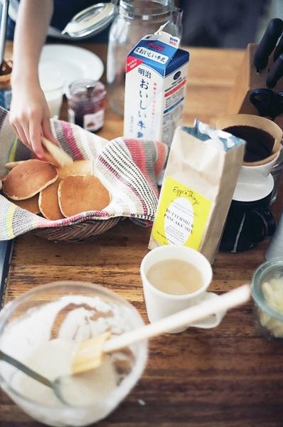 Sunday breakfast. Pancakes, jam, coffee and milk.