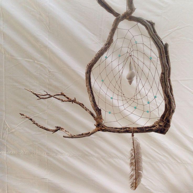 Driftwood dreamcatcher with glass beads, hemp cord, a seashell and a turkey feather #driftwood #dreamcatcher #seashells #beadwork #handmade #handicraft #feathers