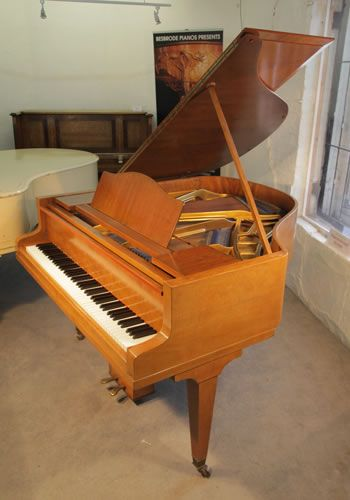 A 1935, Bluthner Baby Grand Piano For Sale with a Fiddleback Mahogany Case and Square, Tapered Legs at Besbrode Pianos. Piano has an eighty-eight note keyboard and two-pedal lyre.