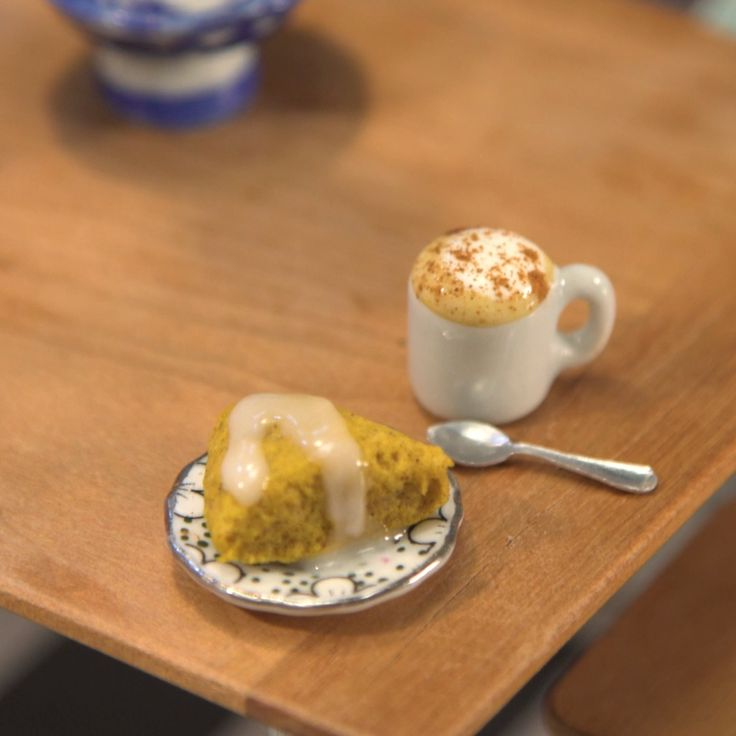 Get in the spirit of fall with a tiny pumpkin scone and adorable lil latte.