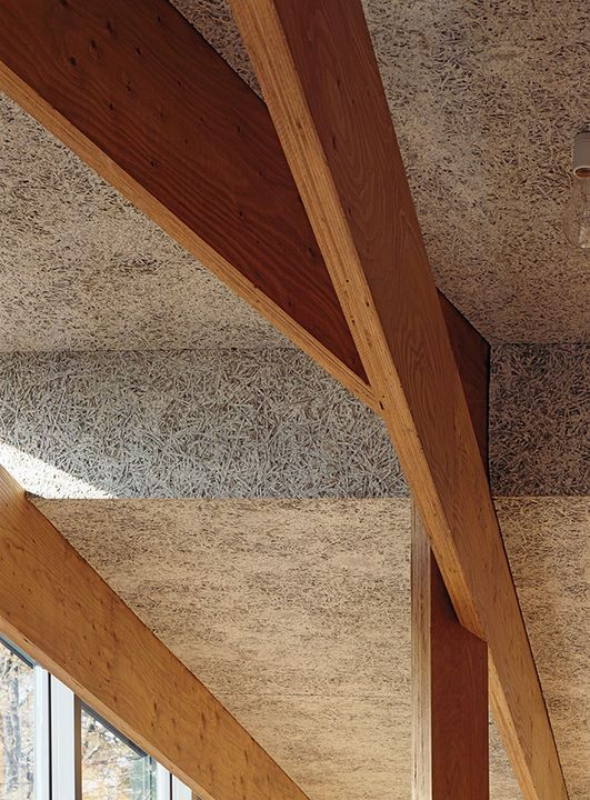 Wood-fiber cement panelsby Koa Funen line the interior, and the criss-crossing laminated veneer lumber beams are from Key-Tec.
