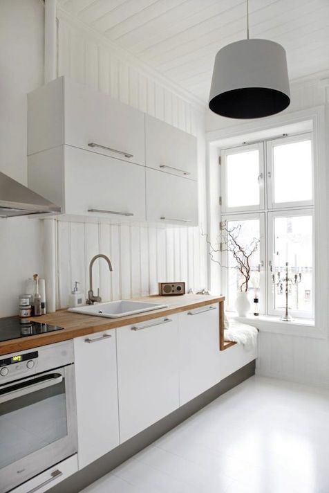 Kitchen inspiration:  wood counters with white cabinets, walls, floors