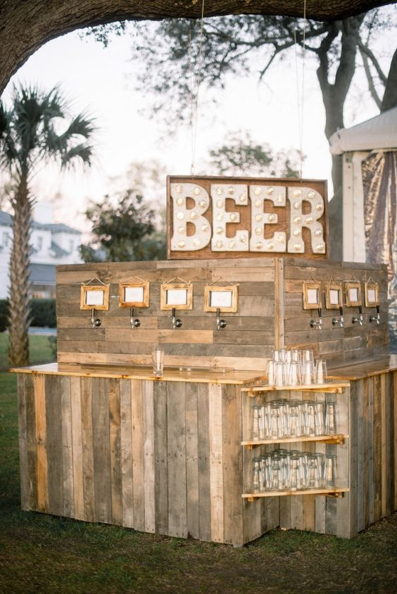 This rustic beer bar is the perfect accent for any outdoor wedding reception. Take a cue from these real couples, who had outdoor cocktail hours, refreshing signature drinks, ice cream and snow cone carts, beautifully decorated tents, and so much more. Get inspired with our best ideas from summer weddings.