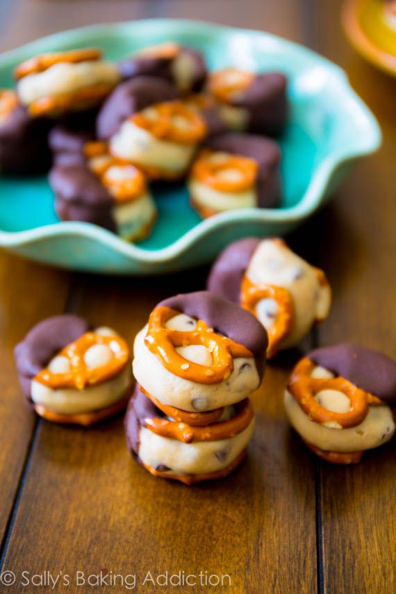 Cookie Dough Pretzel Bites. Safe-to-eat cookie dough stuffed between two salty pretzels and dunked into chocolate. Addicting!