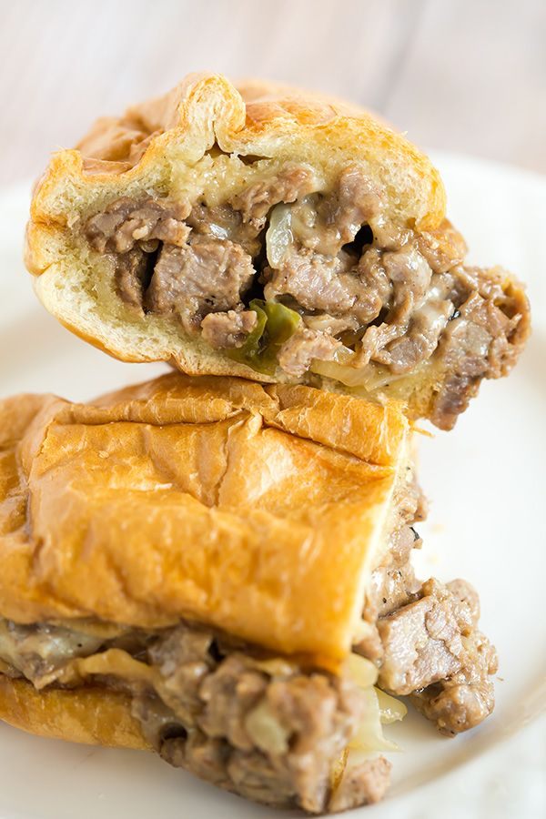These Philly cheesesteak sandwiches are so easy to make at home - the meat is super tender and, most importantly, they're ultra cheesy!