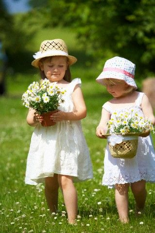 This is Clementine and Agatha out picking some flowers for their mom's.