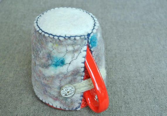 Felted Drink Holder With Dark Blue Edge and White Eyelet