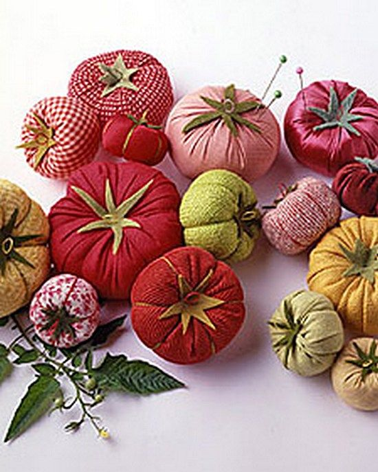 """I ❤ to sew . . . Tomato Pincushions- A bumper crop of pincushions in different sizes & fabrics is both pretty & practical in this project from """"Martha Stewart's Encyclopedia of Sewing & Fabric Crafts."""" Tools & Materials: Sewing shears, Needle & thread, Heirloom-tomato cap template, Cotton or any other medium-weight fabric (such as corduroy or velvet), Cotton or polyester fill, Large embroidery needle, Perle cotton, Scraps of green felt (for caps), Disappearing-ink fabric pen, Fabric glue"""