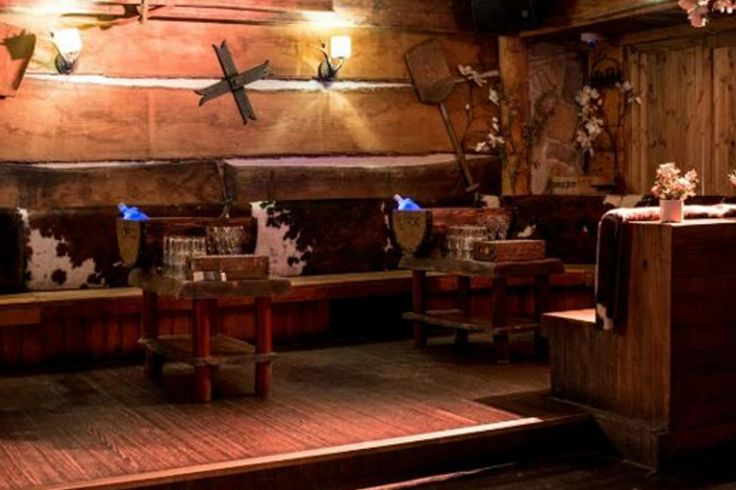 Furnished with authentic Austrian artefacts, Bodos Schloss immerses guests into an Alpine world. Being an immersive design project decorative elements include traditional ginghams, cow hide booth seating and a bubble ski lift turned DJ booth. - specialist fit out - nightclub - austrian ski chalet - 2012 - London -