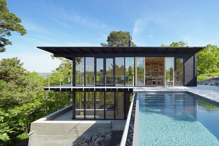 Located near Stockholm, on a steep hillside with pine trees surrounding it, this house has a breathtaking look as well as the view of the Baltic Sea.