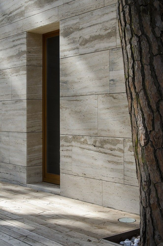 Pine tree and travertin stone. The Pinewood of Marina by Massimo Fiorido Associati.