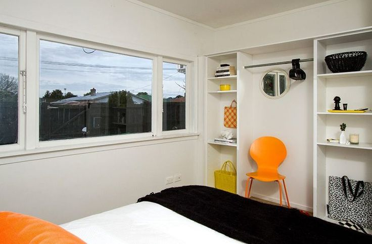 #Funky bedroom. #black and orange. Staging by Places and Graces. Photo courtesy of @Harcourts State Office