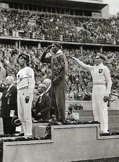 Jesse Owens, USA, Berlin Olympics 1936. Owens won four Gold Medals in the 100m, 200m, 4x100m relay and the long jump. He managed to break or equal nine Olympic records and also set three world records. One of those world records was in the 4x100m relay. Owens salted the American flag during the National Anthem while the German medalist did the Heil Hitler. Owens, the son of a sharecropper and grandson of a slave, achieved what no Olympian before him had accomplished.