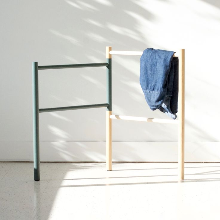 Pivot | folding clothing storage or rack made from solid ash. This collapsible clothing rack offers additional storage for the bedroom or living room.