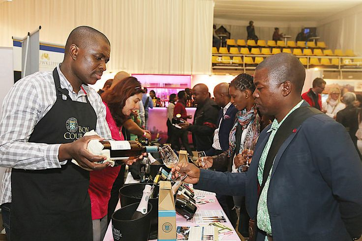 Thebe and Newman taste Bon Courage wines at the 10th TOPS at SPAR Soweto Wine and Lifestyle Festival. over 900 of SA finest wines were showcased.