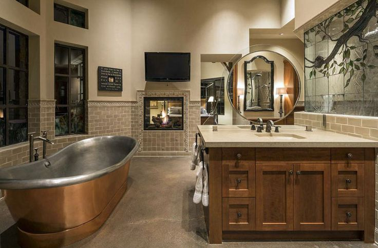 Craftsman master bathroom with brushed copper and polished nickel bathtub