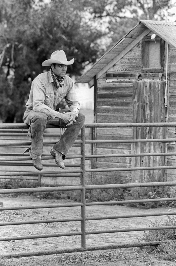 A cowboy and a fence