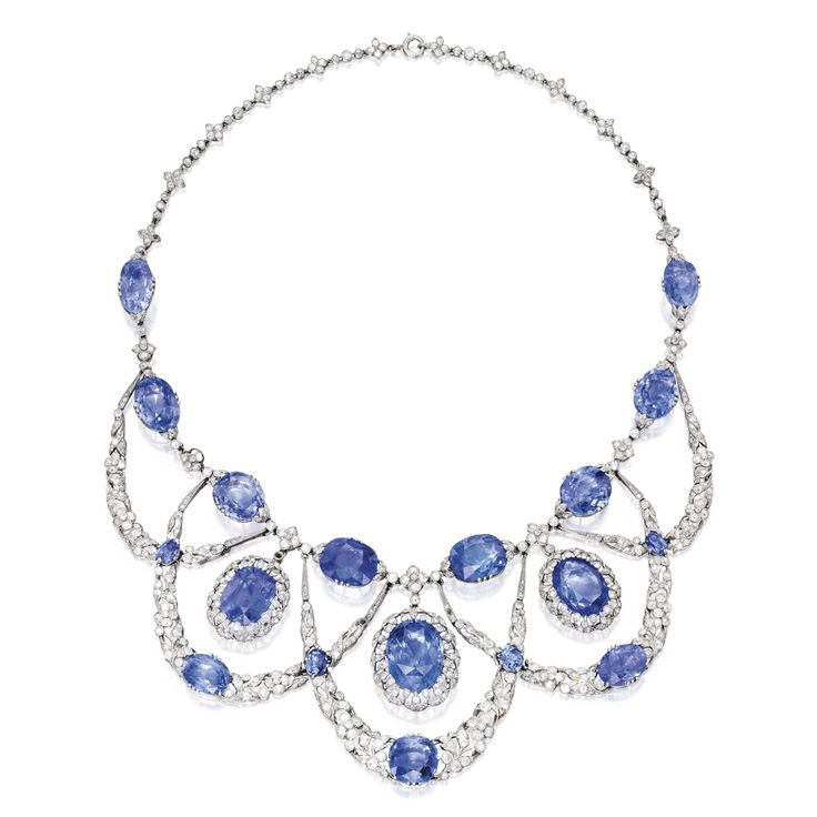 PROPERTY FROM THE FAMILY OF J.J. HILL Platinum, Sapphire and Diamond Necklace, France The swag necklace of garland design, set with 18 cushion and oval-shaped sapphires weighing 100.00 carats, accented by old mine, old European, single and rose-cut diamonds weighing 10.75 carats, circa 1910.