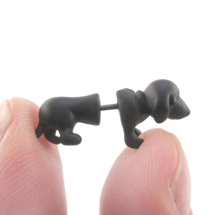 - Description - Details These front and back stud earrings are made to look like miniature Dachshunds in black! When worn it looks as if the puppy is piercing through your ear lobes! For more fake gau