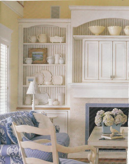 I love the attention to detail with the striped bkground in the cabinets! This room is inviting...!
