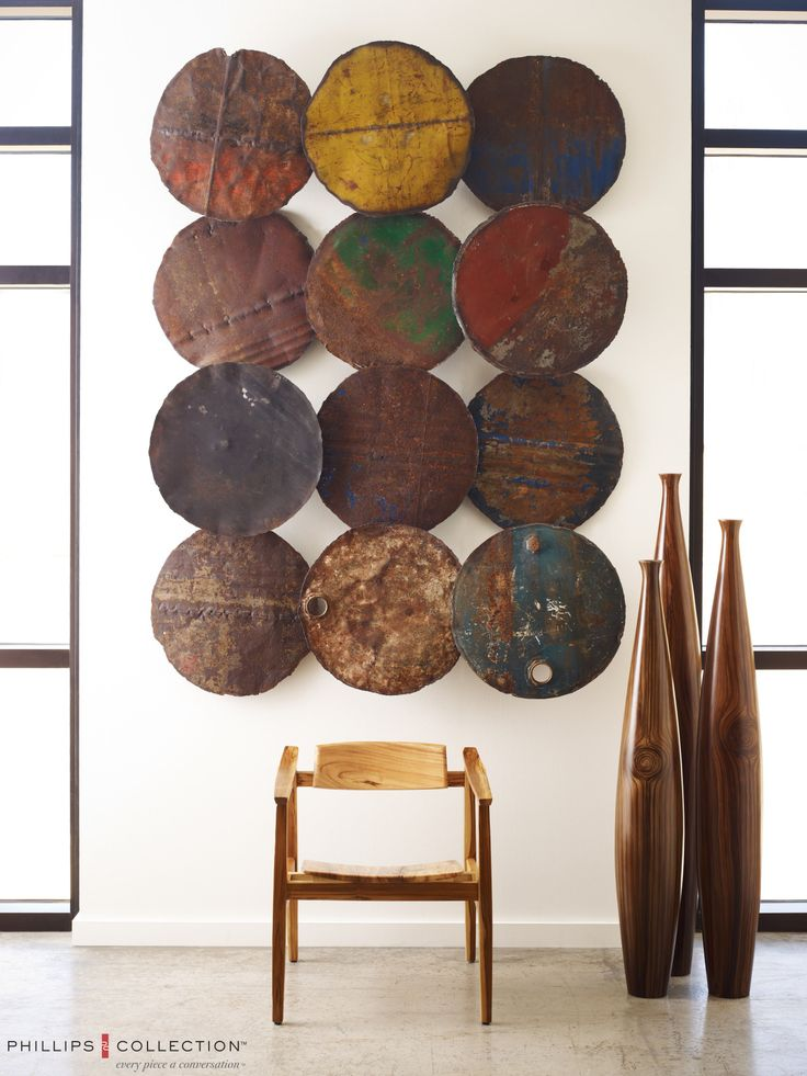 Phillips Collections galvanized Wall Decor is made from Recycled oil drums.