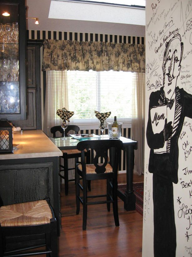 The wall entering the kitchen is a hand painted cartoon waiter pointing to  the dining room that guests can sign as they leave. The tabletop is a French  door ...