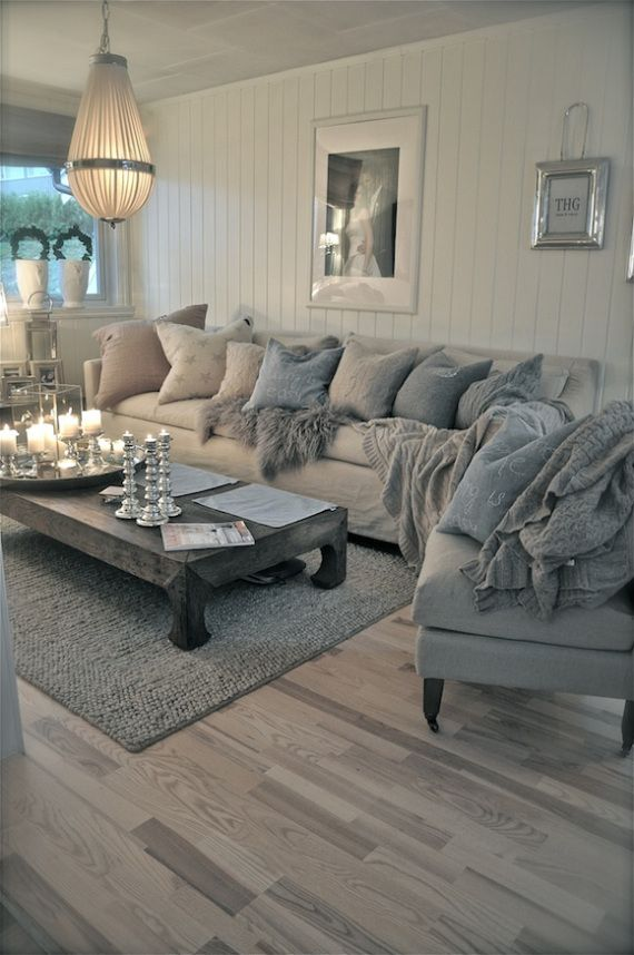Blue and grey living room. Not quite sold on the lighting... Loooove the sofa!
