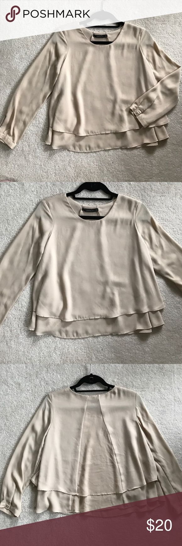 Zara beige long sleeve top. Long sleeve top that fits slightly cropped with cute back detail (sheer panel in back to show a little sexiness.) Pair with black leather skinny jeans or leggings. Zara Tops Blouses