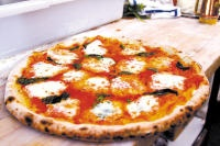 Uncie Ro's traveling pizzeria, Santa Cruz.  Find one of these awesome pizza's at a New Leaf Store or a local farmers market.  2901-B Research Park Dr Santa Cruz, CA 95060