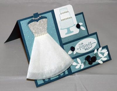 "Stampin' Up! Wedding Dress Side Step Card...Spring Catalog Dress Up Framelits  Stamps: Make A Cake, Bloomin' Marvelous  CS: Whisper White, Not Quite Navy, Baja Breeze, Silver Glimmer Paper  Ink: Baja Breeze, Not Quite Navy, Illuminate Glimmer  Accessories: Crepe Filter Paper, Pearls, Perfect a polka Dot Embossing Folder, Lg Oval, 3/4"", 1/2"", and Bird Builder Punches"