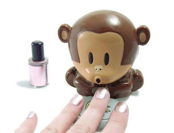Blow Monkey Nail Dryer ($9 USD)  This nail dryer is unlike any beauty gadget you've ever seen before. Press on the monkey's plate of bananas and this sweet little simian blows cool air onto your wet nails.   The air jet is just powerful enough to help your nails dry more quickly, but not so powerful that it blows your carefully applied polish off.