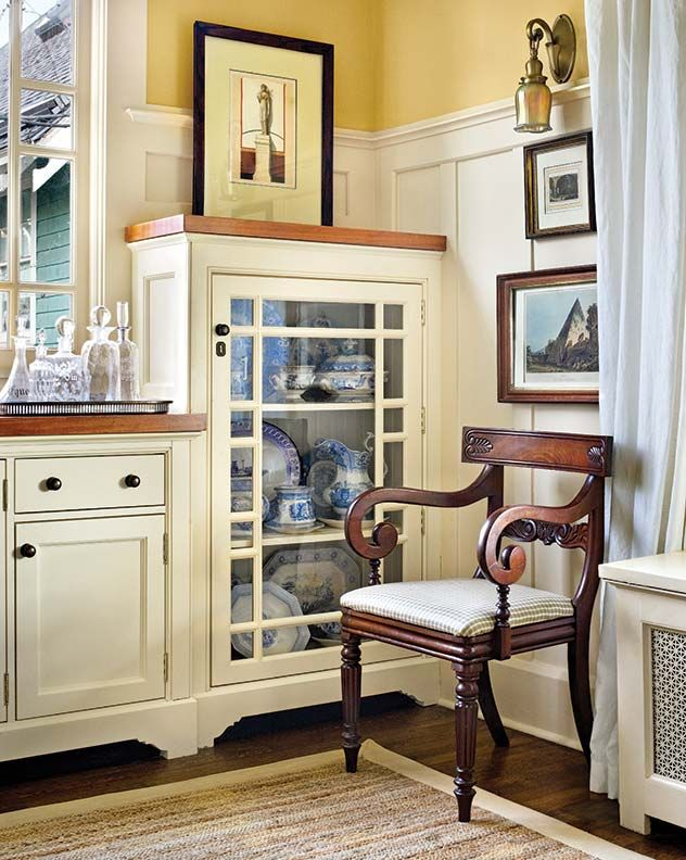 The kitchen cabinets' design continues to a built-in buffet.